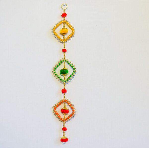 Latkan green orange and yellow chakri, multicolor pompoms handmade wall hanging