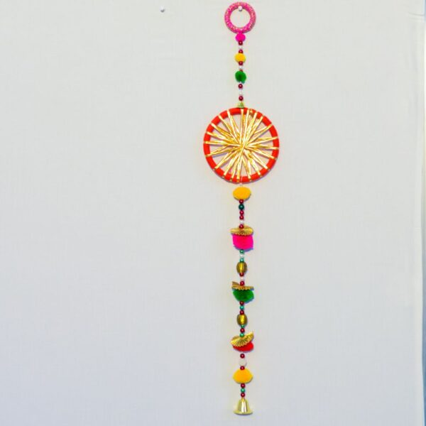 Latkan-red-chakri-with-yellow-strips-pompoms-small-golden-bell-handmade-wall-hanging