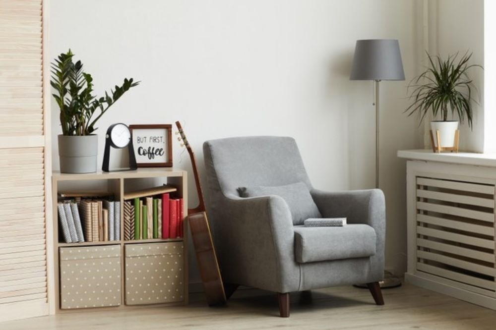 cozy reading nook modern minimal interior focus grey armchair against white wall 236854 22650 2