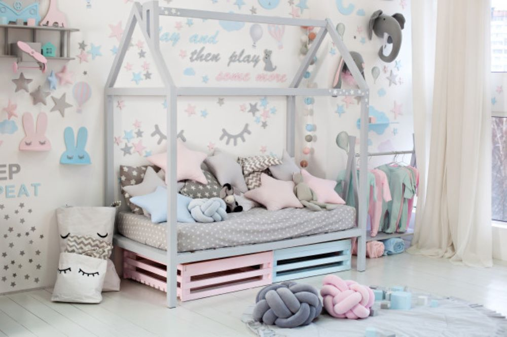 empty cozy children s room with white wall with stickers toys bed with pillows scandinavian interior children s room wooden bed shape house with toys blanket kindergarten 1