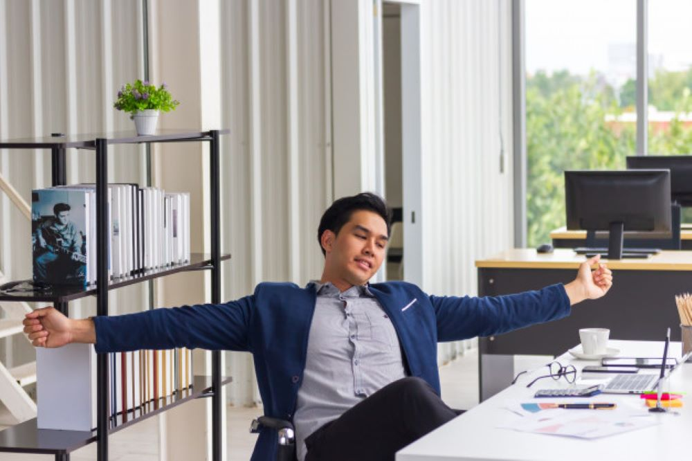 young businessman worker taking break work relaxing sitting ergonomic chair office desk resting finished computer work found solution with job well done 33779 191